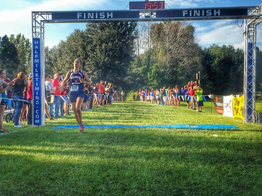 Wakulla junior Haleigh Martin crosses the finish line in sixth place during the Region 1-2A meet in Lake City.