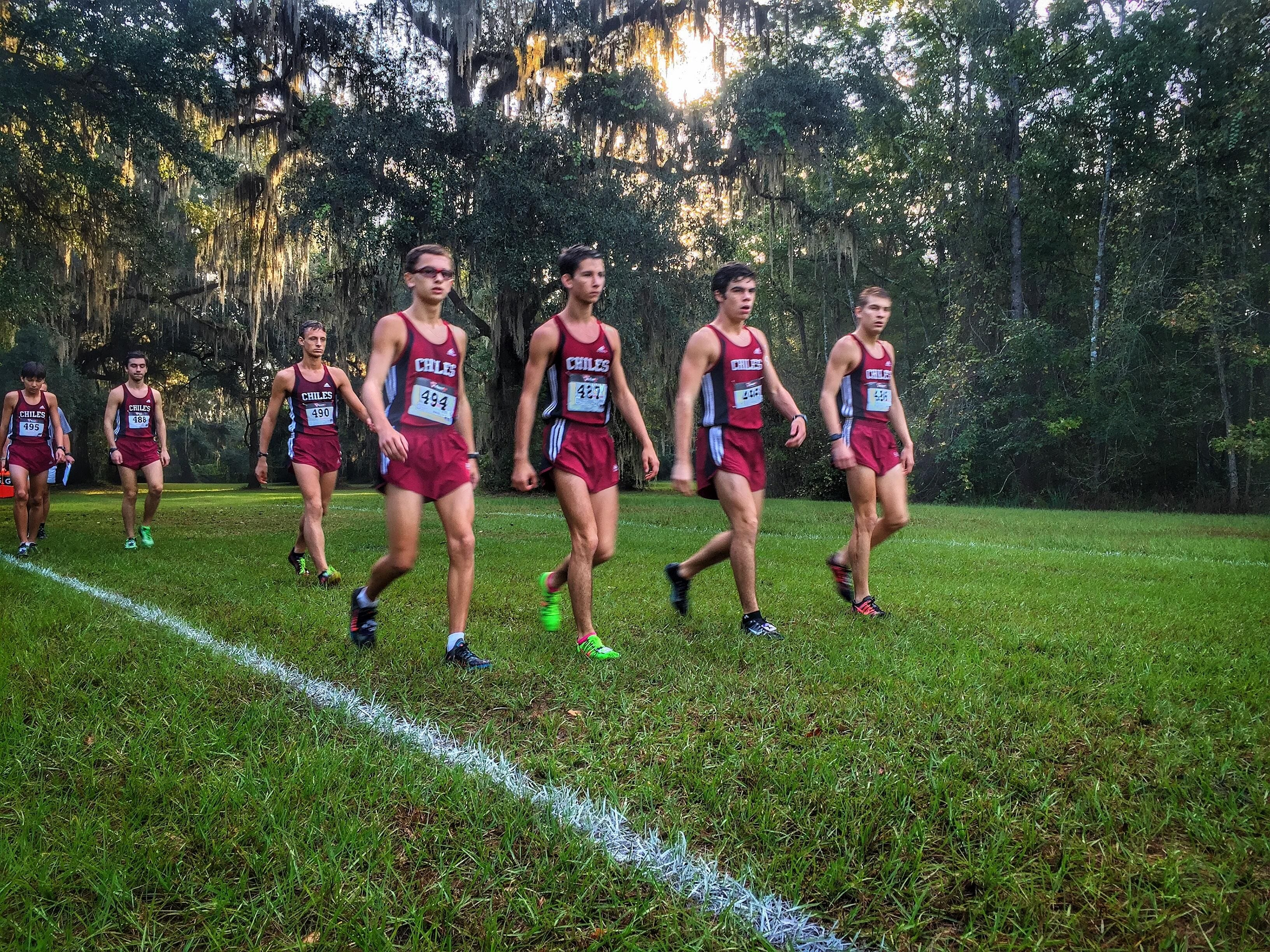 Chiles' boys cross country team walks towards the starting line during Saturday's Region 1-3A meet at Alligator Lake in Lake City. The Timberwolves finished as the region runner-up, setting up their return to the state meet where they will defend their back-to-back state titles.