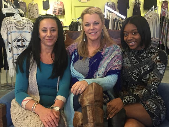 Store manager Lulu Dickow, co-owner Beth Krankow and C'est La Vie staffer Jade Hall.