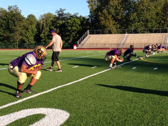 The Union City football team stretches prior to Wednesday practice at Delone Catholic High School.