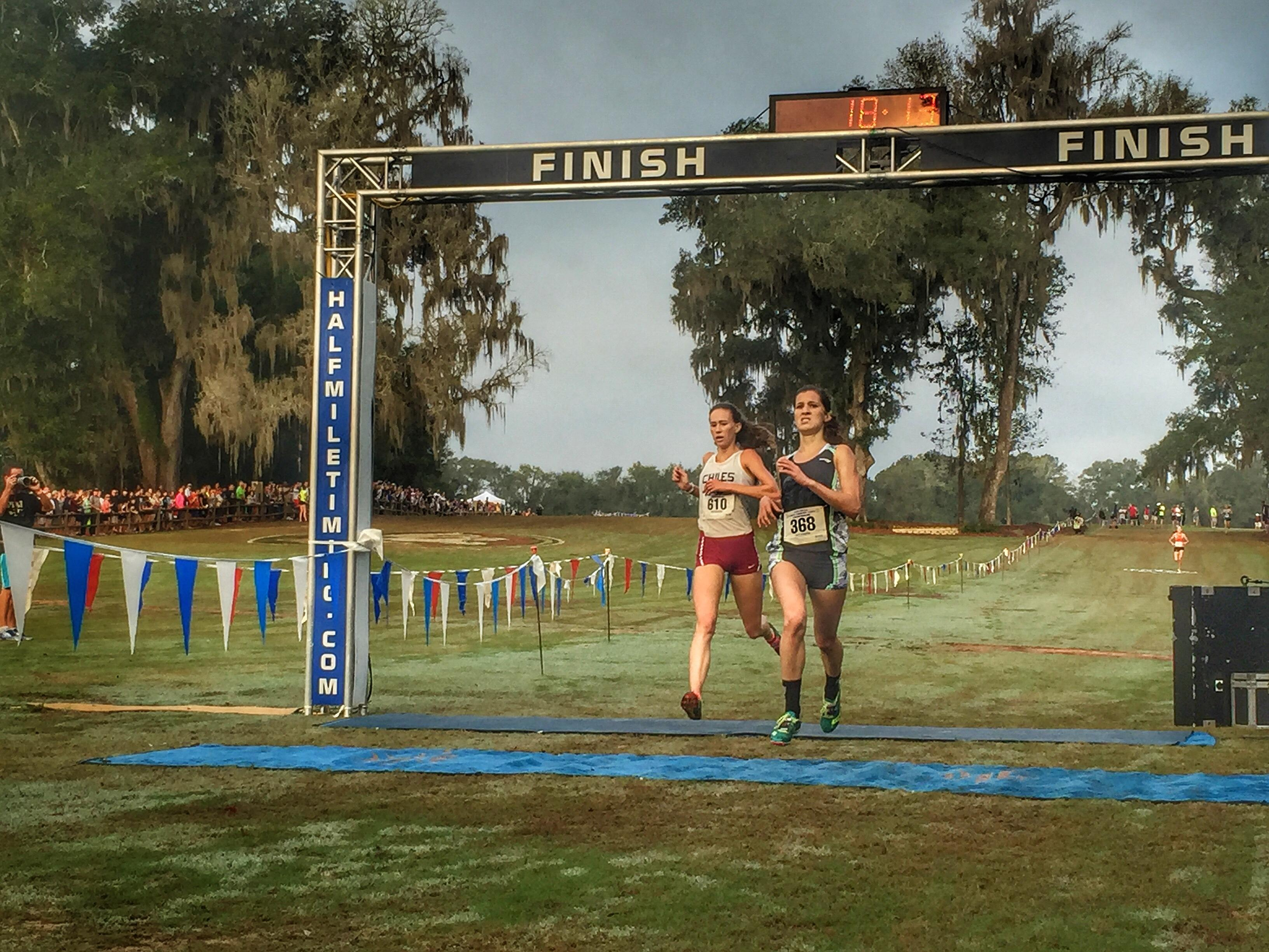 Chiles senior Emma Tucker gets nipped by Fort Myers' Krissie Gear at the finish line of Saturday's FHSAA Class 3A state cross country race at Apalachee Regional Park. Tucker finished third and the Timberwolves won a state title.