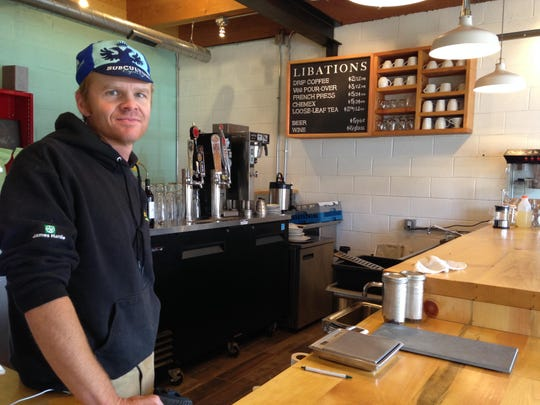 Todd Simmons, founder and director of Wolverine Farm Publishing, stands in the coffee bar area of Wolverine Farm Letterpress & Publick House, in this 2015 photo.