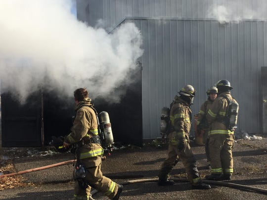 Firefighters with Great Falls Fire Rescue and the Montana Air National Guard participate in live burn training Tuesday.