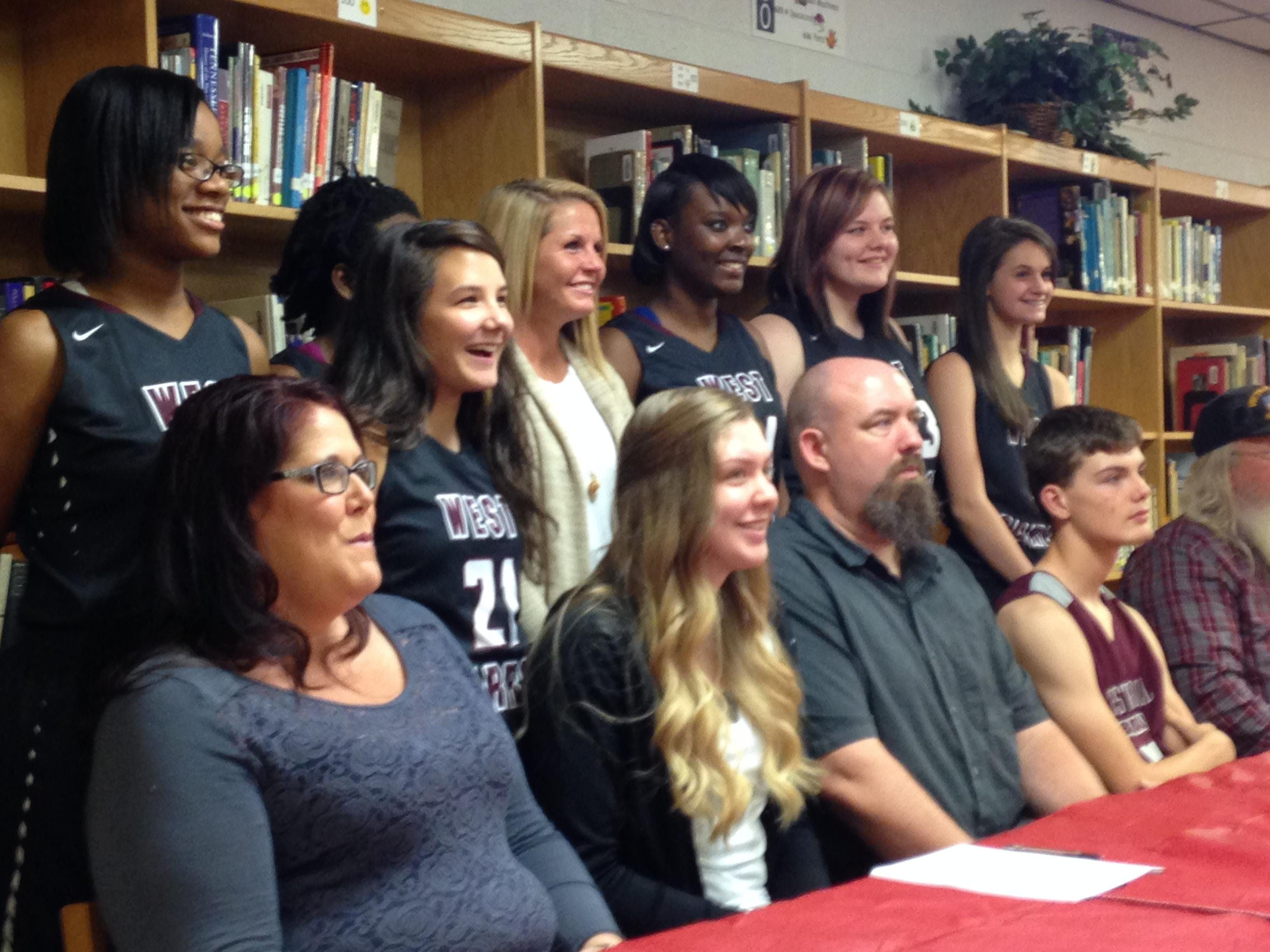 West Carroll senior Madison Heckert signed with Arkansas State basketball Wednesday in front of family members and classmates.