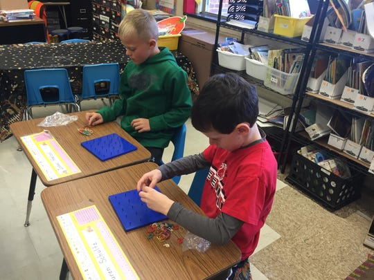 Elias Yoder (left, in green shirt) and Aiden Schumacher are Lakeview students who participated in a POWER (Play Our Way Extra Resource) Day on Oct. 27. Students, teachers and parent volunteers participated a variety of math game rotations, literacy activities and published writing celebrations.