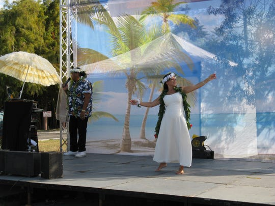 Marliss Brockington dances to the Hawaiian Wedding Song, sung by Tona Wong, during the Coconut Festival in Cape Coral. This year's festival continues through Sunday.