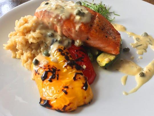 A classic caper dill sauce drapes pan-seared salmon.
