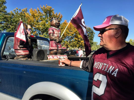 "Jeff Bragg Sr. of Great Falls has chainsaw carvings of Monte and Mo at his tailgate ""to support Griz Nation."" He said, ""There's nothing Griz I don't have."""