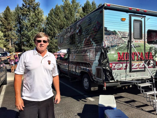 Brian Robertson, a Malta native, said people stop to pose for pictures with his custom-wrapped Griz camper and pickup.
