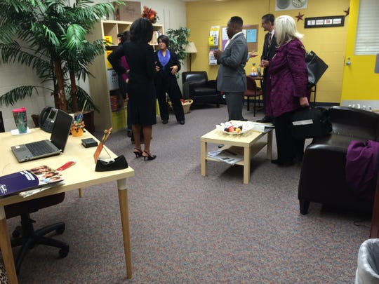 Staff check out the new parent resource room at Wood Creek Elementary School.