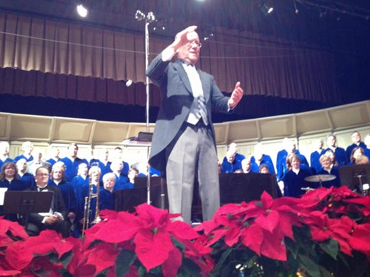 "Coshocton Community Choir Director Chuck Snyder leads the audience in a group chorus of ""Silent Night"" at the Coshocton Community Choir's annual Christmas Festival Concert."