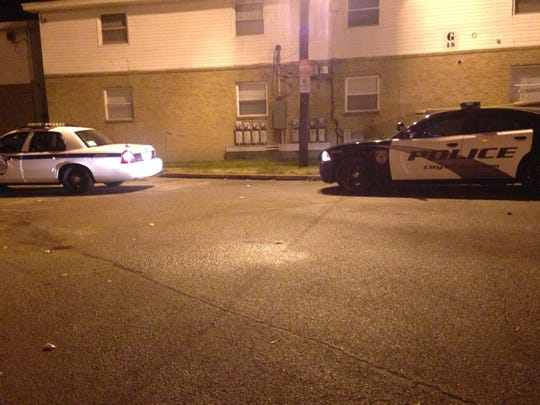 Officers were seen investigating at the B Building at Parkway East Apartments at 33 Carver Ave. Friday night.