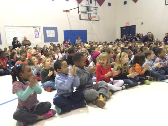Lanigan Elementary students react after hearing the quartet play.
