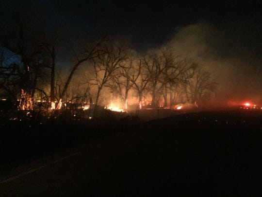 """""""It will burn all night,"""" Randy Perez said of a fire Burning east of the community of Fort Belknap, which high winds are fueling."""
