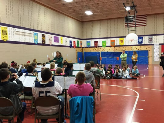 Maplewood Middle School band students, under the direction of Jeanne Jung, performed for Nicolet's fifth-grade students. The fifth-grade students are given the opportunity to hear both band and string instruments, which allow them to choose an instrument they would like to learn how to play.