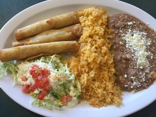 A trio of chicken flautas anchors a combination plate at El Paisano 2.