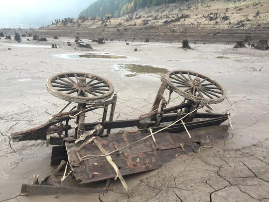 A 19th-century utility wagon was found lying lakeside in the mud when the Detroit reservoir drained to 143 feet below capacity.