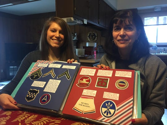 Cassie Bunker and her mom Janice Bunker show the scrapbook of memorabilia they are assembling.