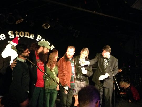 """Scott Stamper and the crew of The Saint nightclub in Asbury Park accept the """"Top Live Original Music Venue (Small)"""" award at the Asbury Music Awards Dec. 17 at The Stone Pony in Asbury Park."""