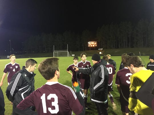 Chiles coach Bryan Wilkinson speaks to his team during a water break of a 2-1 win at Florida High.