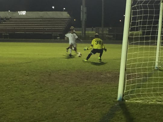 Florida High junior Johnny Garcia streaks in to find a goal past Chiles keeper Logan Henry during the first half of Monday's 2-1 win by the Timberwolves.