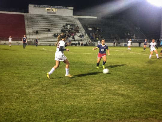 Florida High's Mackenzie Whitmore and Wakulla's Emily Lawrence go for the ball during the first half of the Seminoles' 1-0 win over the War Eagles in the District 2-2A final.