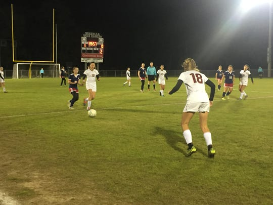 Florida High junior Taylor Cherry plays a ball along the sideline during a 1-0 win at Wakulla on Thursday for the district title.