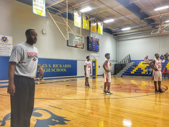 Leon coach Rick Davis prepares his team to play during the MLK Inspire Classic at Rickards on Monday, while son Trejan, far right, braces for FAMU DRS.
