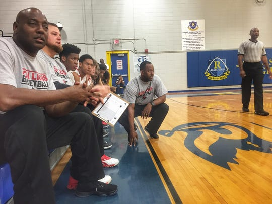 Leon coach Rick Davis, kneeling, is in his eighth year at the school and is only the second African-American head coach in the school's history.