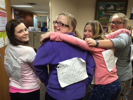 Sixth-grade students, from left, Carlee Noll, Abbie