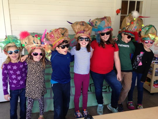 "Vermont Day School students wear Mad Hatter hats from ""Alice in Wonderland"" that they created in art class."