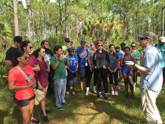 An FGCU instructor leads his class during a hike at CREW Land & Water Trust.