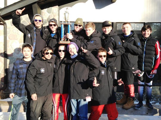 The White Lake Lakeland boys ski team hoists the SEMSL