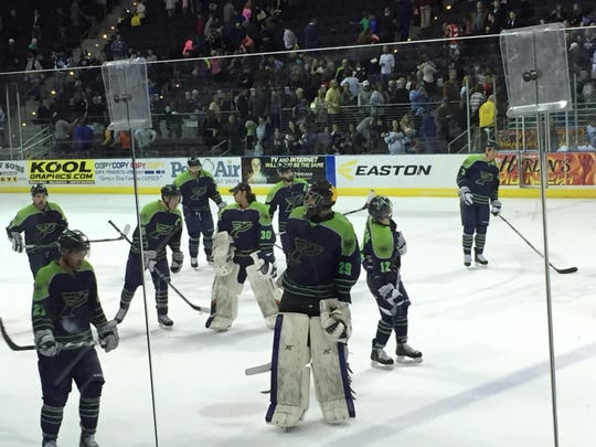The Ice Flyers gather before leaving the ice after Friday night's 3-2 loss against Mississippi RiverKings.