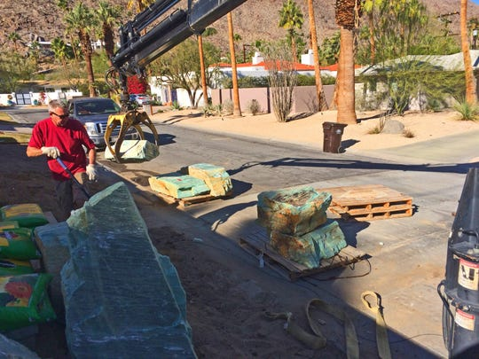 Troy Williams guides the rock crane in placing these huge chunks of stone into these entirely handmade gardens.