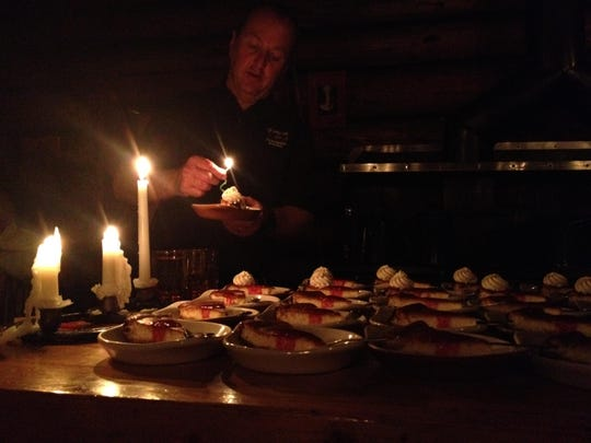Lone Mountain Ranch chef prepares dessert by candlelight.