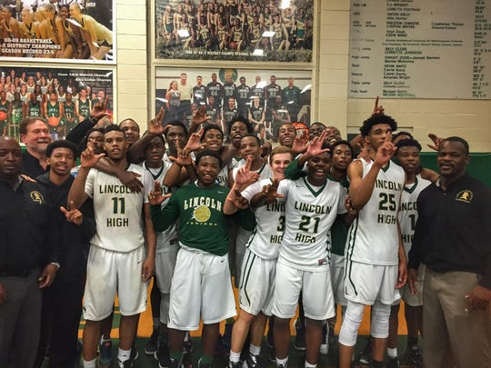 The Lincoln Trojans boys basketball team is headed to the state tournament for the first time in school history thanks to a 57-54 win over Creekside in Friday night's Region 1-7A final.