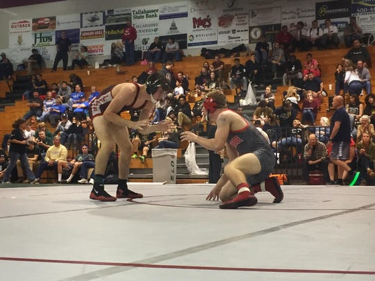Lincoln wrestler Justin Grant (152) ran his record to 43-1 on the season by winning a regional title on Saturday.