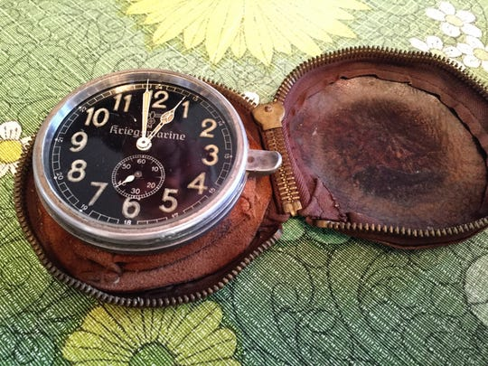Above: A submariner's watch is in Wisse's collection of artifacts from World War II.