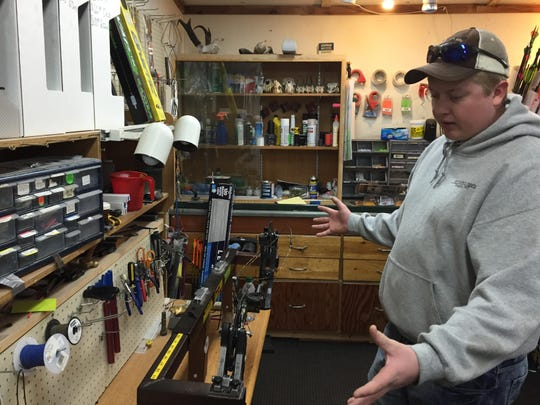 Matt Heinert explains how a bow press works. The press is used when repairing and restringing bows.