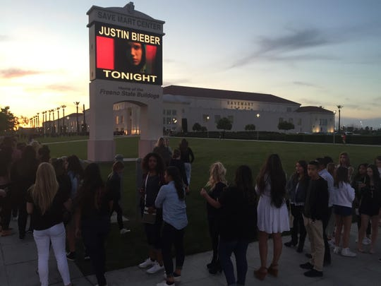 The line to see Justin Bieber Saturday wrapped in both