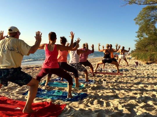 Yoga on the beach at Delnor-Wiggins Pass State Park at once provides the serenity of nature while presenting challenges to improve your form.