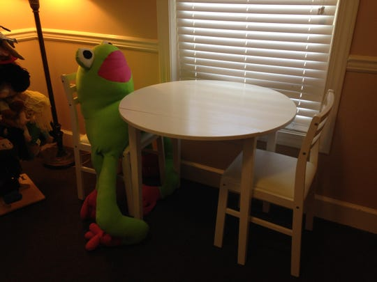 The Child Advocacy Center keeps this stuffed frog toy in a therapy room because children enjoy holding it during the sessions.