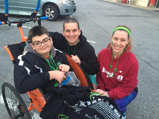 Preston Buenaga, from left, Nic and Kattie Mackie before the Shamrock 8K race in Virginia Beach, Virginia.