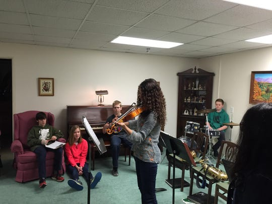 Mater Christi student Isabel Stearns of Burlington plays the violin during the concert for the Sisters of Mercy.