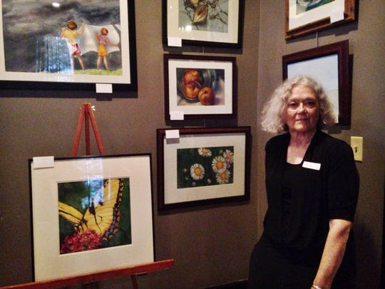 Rose Byrum displays her artwork at West Tennessee Hearing and Speech Center's fourth annual Speaking of Art fundraising event.