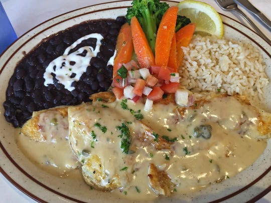 Sand dabs in a lemon caper sauce at The Golden Fish