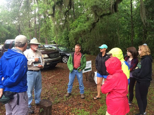 Volunteers learn more about Lake Iamonia from Micheal Hill.