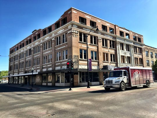 Developers are preparing to rebuild the Rocky Mountain Building, seen this week after protective wooden barriers were removed.