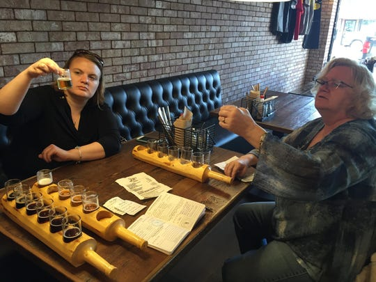 Patrons consider beer in flights at Meadowlark Brewing in Sidney.